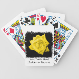 A yellow rose with black back jagged  frame bicycle playing cards