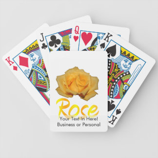 A yellow rose with the word rose underneath bicycle playing cards