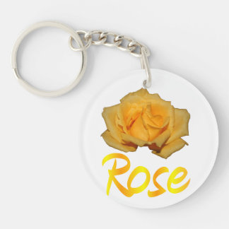 A yellow rose with the word rose underneath acrylic keychains