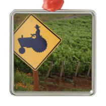 A yellow tractor crossing sign in the vineyard metal ornament