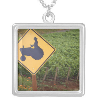 A yellow tractor crossing sign in the vineyard silver plated necklace