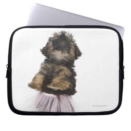 A Yorkie-poo puppy in a tutu on her hind legs. Computer Sleeves
