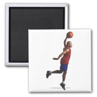 a young adult male basketball player flies 2 inch square magnet