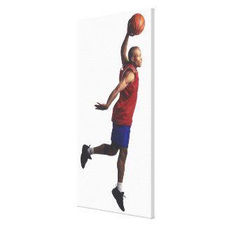 a young adult male basketball player flies canvas print