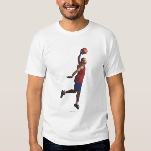 a young adult male basketball player flies dresses