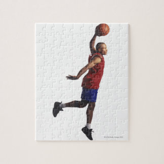 a young adult male basketball player flies jigsaw puzzle