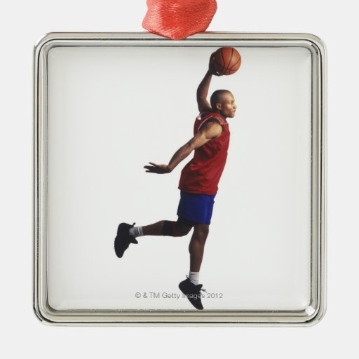 a young adult male basketball player flies metal ornament