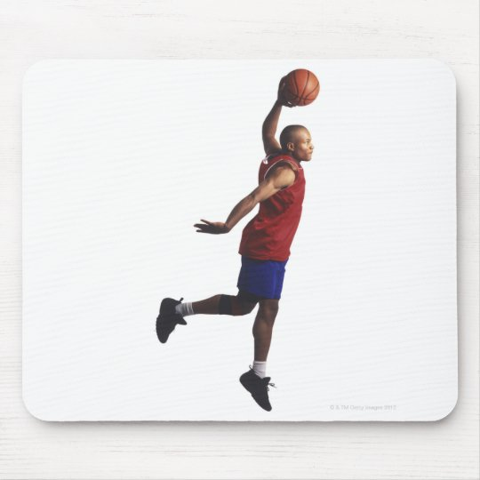 a young adult male basketball player flies mouse pad
