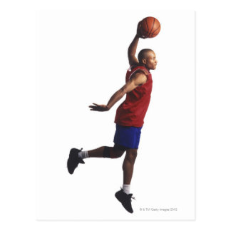 a young adult male basketball player flies postcard