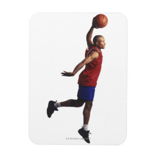 a young adult male basketball player flies rectangular photo magnet