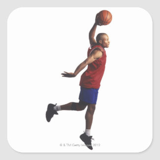 a young adult male basketball player flies square sticker
