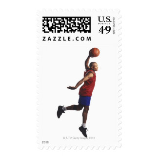 a young adult male basketball player flies stamps