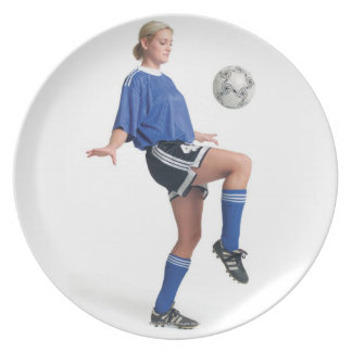 a young blonde caucasian female in a blue soccer dinner plate