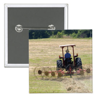 A young boy driving a tractor harvesting pinback button