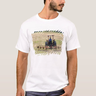 A young boy driving a tractor harvesting T-Shirt