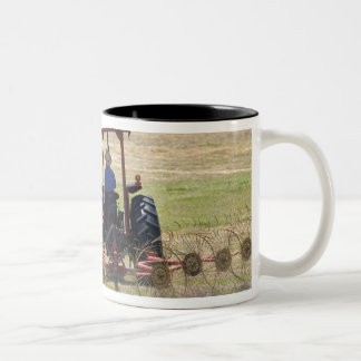 A young boy driving a tractor harvesting Two-Tone coffee mug