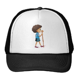 A young boy hiking trucker hat