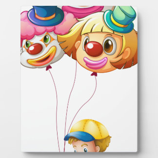 A Young Boy Riding a Bike with three Balloons Plaques