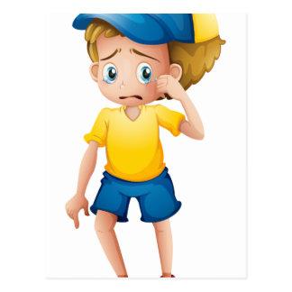 A young boy sobbing postcard