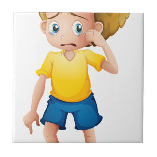 A young boy sobbing small square tile