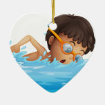 A young boy swimming with a yellow goggles Double-Sided heart ceramic christmas ornament