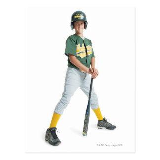 a young caucasian boy is wearing a green little postcard