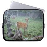 A young deer in a forest clearing laptop sleeve