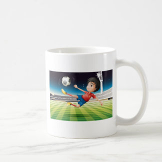 A young football player with a red uniform classic white coffee mug