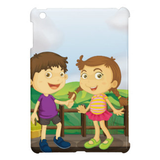 A young girl and a young boy at the wooden bridge case for the iPad mini