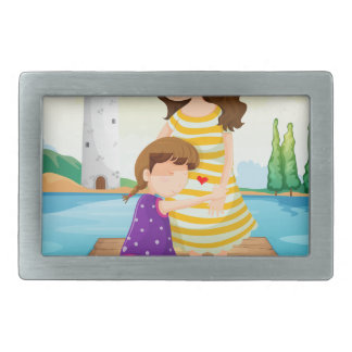 A young girl hugging her mother at the bridge belt buckle