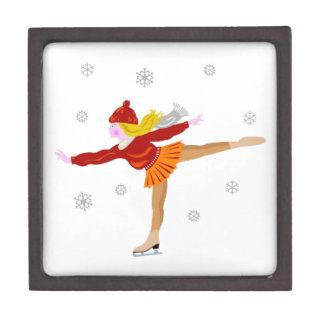 A Young Girl Ice Skating as Snowflakes Fall Gift Box