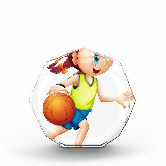 A young girl playing basketball award