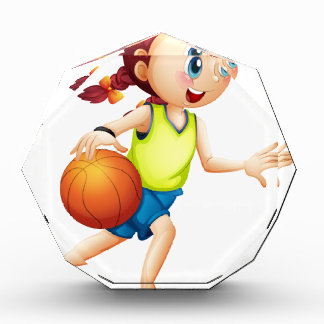 A young girl playing basketball acrylic award