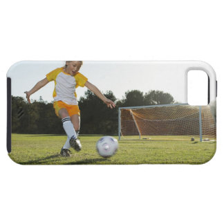 A young girl playing soccer on a soccer field in iPhone SE/5/5s case