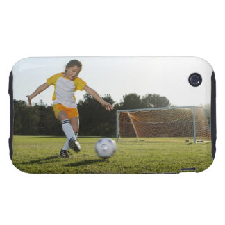 A young girl playing soccer on a soccer field in tough iPhone 3 cover