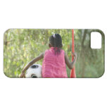 A young girl sits on a bench, holding a Vuvuzela iPhone SE/5/5s Case
