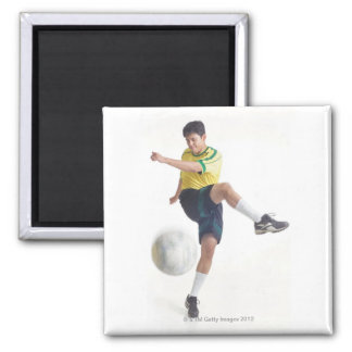 a young latin male wears a yellow soccer jersey fridge magnet