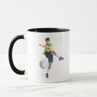a young latin male wears a yellow soccer jersey mug