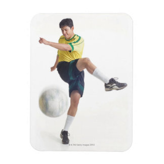 a young latin male wears a yellow soccer jersey rectangular magnet