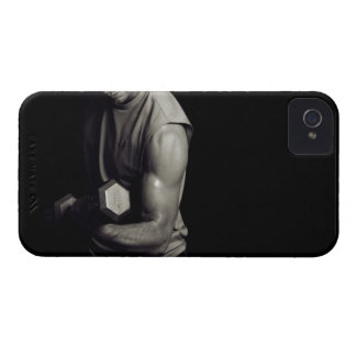 A young man lifts weights. iPhone 4 cases