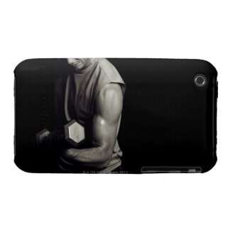 A young man lifts weights. iPhone 3 cases