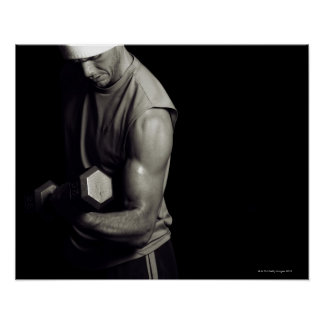A young man lifts weights. print