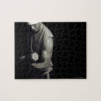 A young man lifts weights. jigsaw puzzles