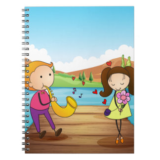 A young man serenading her girlfriend at the river spiral notebook