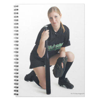 a young smiling caucasian woman is wearing a notebook