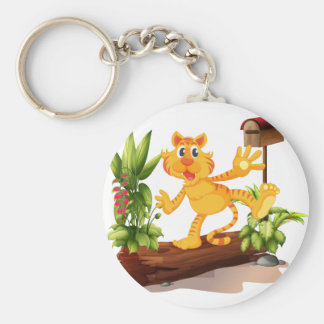 A young tiger at the garden with a mailbox basic round button keychain