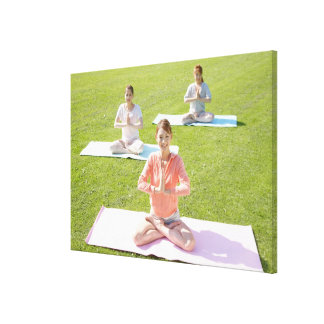 A young woman doing yoga canvas print