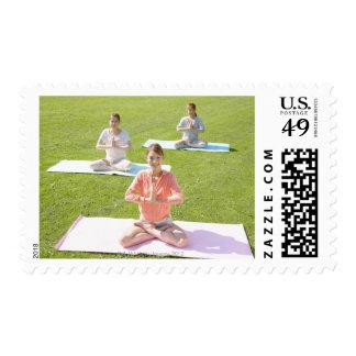 A young woman doing yoga postage