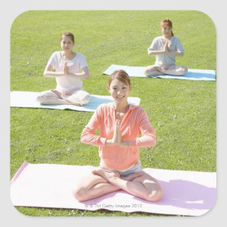 A young woman doing yoga square sticker