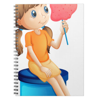 A young woman eating a cotton candy spiral notebook
